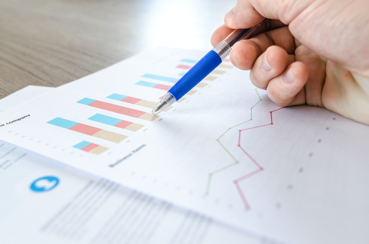 What is the difference between a balance sheet and income statement?