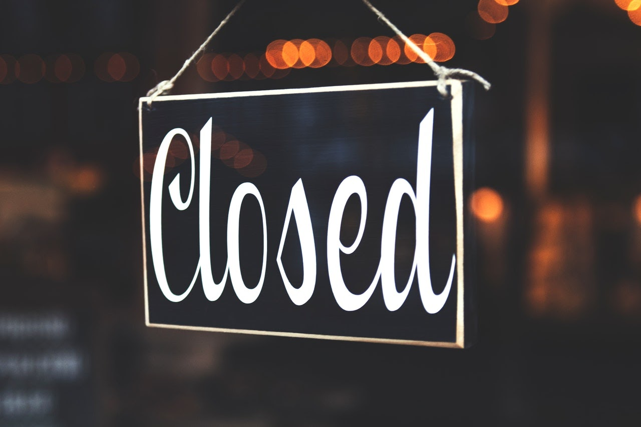 A closed sign, representing month end close in accounting